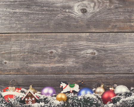 Vintage Christmas background with various colorful decorations on wooden wall photo