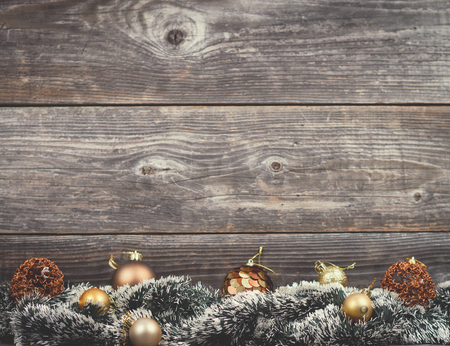 Vintage Christmas tree with golden baubles on wood texture photo