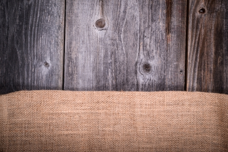 Vintage coffee sack against wooden background photo