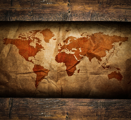 Vintage paper map in old wooden frame photo