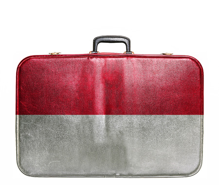 Vintage travel bag with flag of Indonesia photo