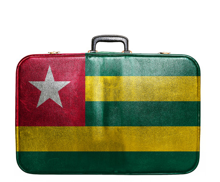Vintage travel bag with flag of Togo photo