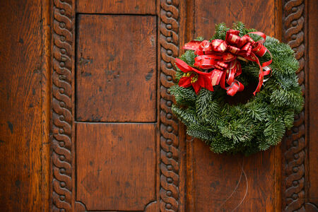 Christmas wreath on wooden door decoration photo