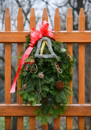 Seasonal Winter Christmas Wreath decoration on a fence photo