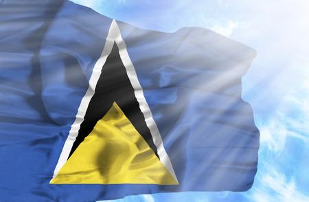 st lucia: St Lucia waving flag against blue sky with sunrays