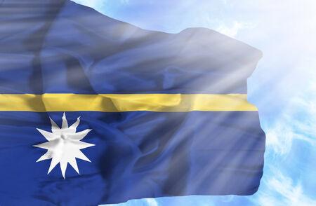 nauru: Nauru waving flag against blue sky with sunrays