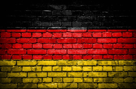 deutchland: Brick wall with painted flag of Germany