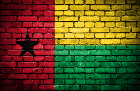 guinea bissau: Brick wall with painted flag of Guinea Bissau