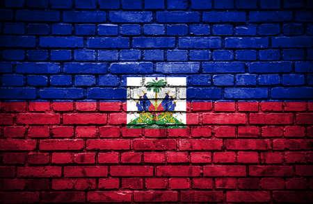 Brick wall with painted flag of Haiti photo