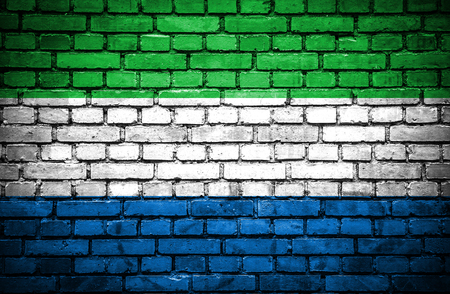 Brick wall with painted flag of Sierra Leone photo
