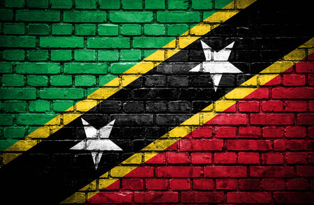 Brick wall with painted flag of St Kitts and Nevis photo
