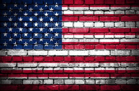Brick wall with painted flag of United States of America photo