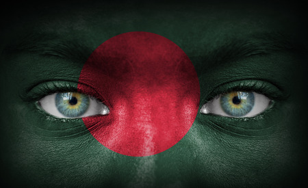 Human face painted with flag of Bangladesh