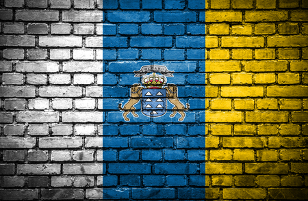 canary islands: Brick wall with painted flag of Canary Islands
