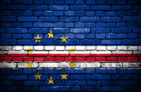 cape verde: Brick wall with painted flag of Cape Verde Stock Photo