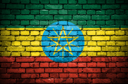 Brick wall with painted flag of Ethiopia photo