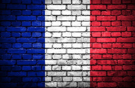 france painted: Brick wall with painted flag of France Stock Photo