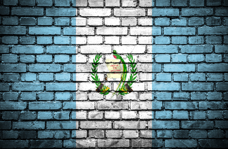 Brick wall with painted flag of Guatemala photo