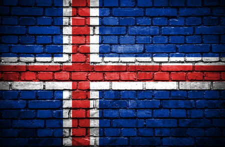 the icelandic flag: Brick wall with painted flag of Iceland Stock Photo