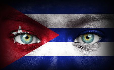 Human face painted with flag of Cuba photo