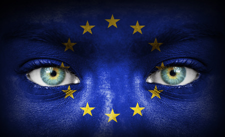 Human face painted with flag of European Union photo