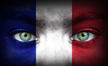 Human face painted with flag of France photo