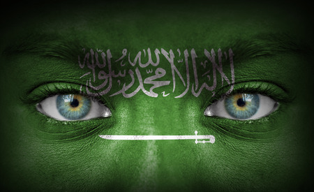 Human face painted with flag of Saudi Arabia photo