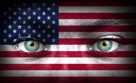 Human face painted with flag of United States of America photo