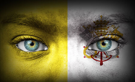 Human face painted with flag of Vatican photo