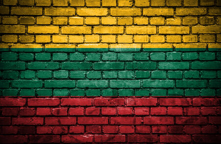 Brick wall with painted flag of Lithuania photo