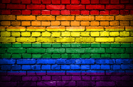 gay flag: Brick wall with painted flag of Pride Stock Photo