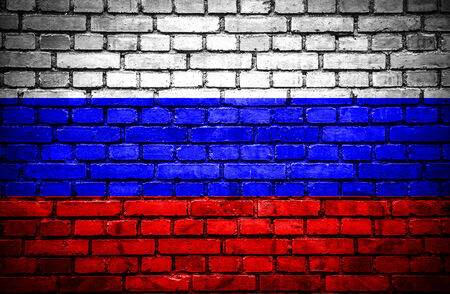 Brick wall with painted flag of Russia