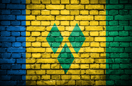 Brick wall with painted flag of Saint Vincent and Grenadines photo