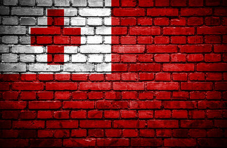 tonga: Brick wall with painted flag of Tonga