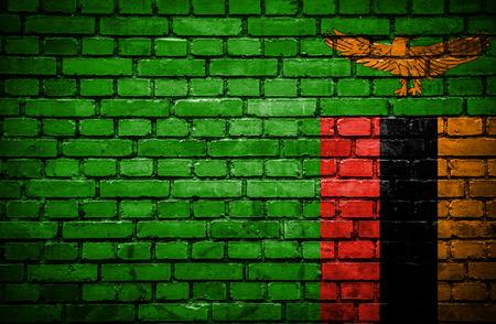 zambian flag: Brick wall with painted flag of Zambia