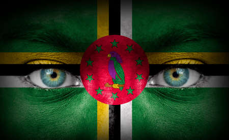 Human face painted with flag of Dominica photo