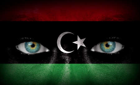 Human face painted with flag of Libya photo