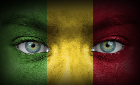 Human face painted with flag of Mali photo