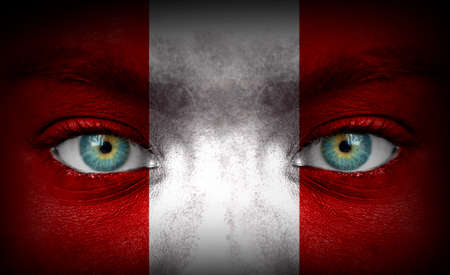 Human face painted with flag of Peru photo