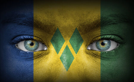 grenadines: Human face painted with flag of Saint Vincent and the Grenadines