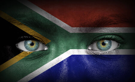 Human face painted with flag of South Africa photo