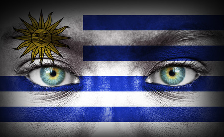 Human face painted with flag of Uruguay photo