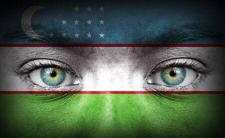 Human face painted with flag of Uzbekistan photo