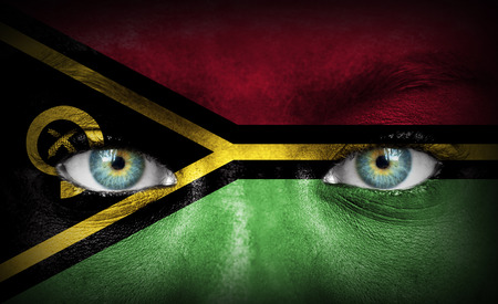Human face painted with flag of Vanuatu photo