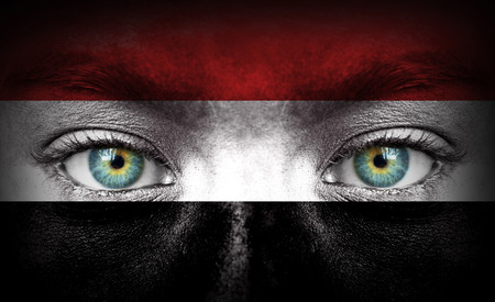 Human face painted with flag of Yemen photo