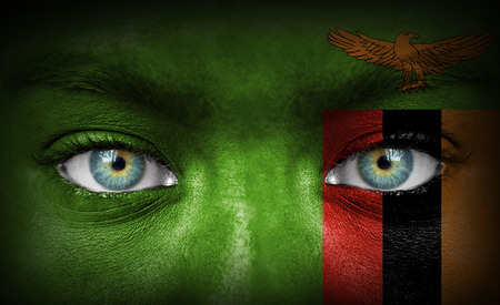 Human face painted with flag of Zambia photo