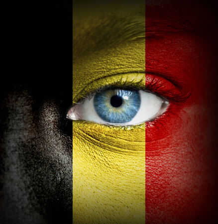 Human face painted with flag of Belgium photo