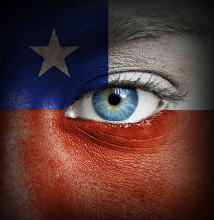 Human face painted with flag of Chile photo