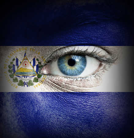 Human face painted with flag of El Salvador photo