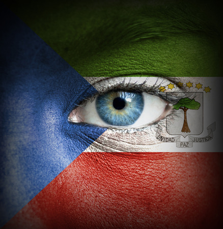 equatorial guinea: Human face painted with flag of Equatorial Guinea